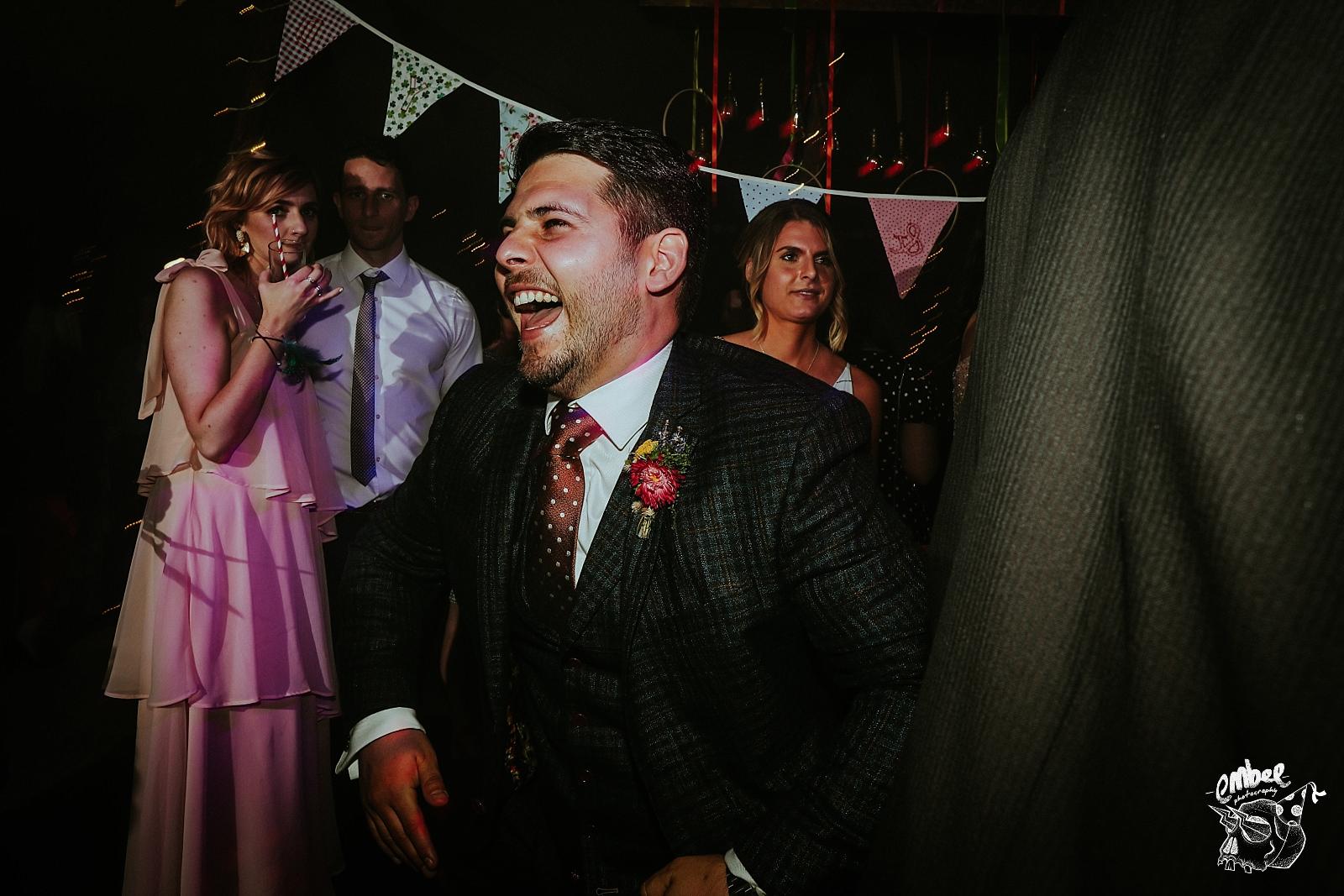 dancing groom