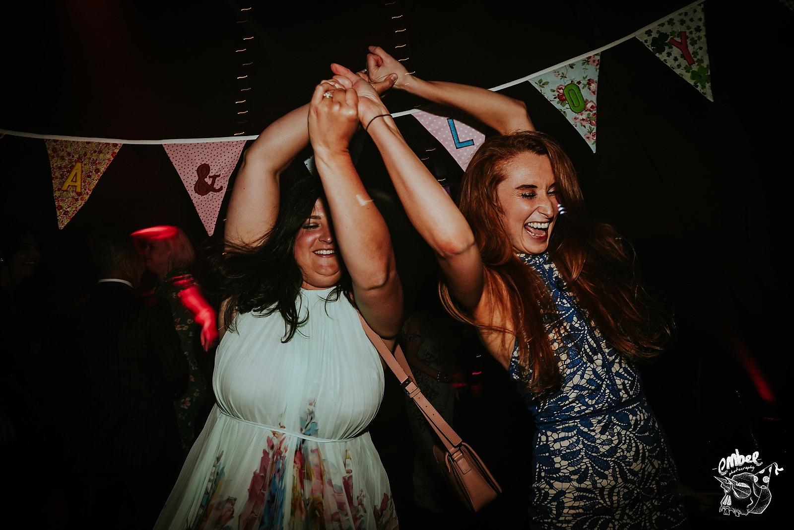 two girls having fun dancing