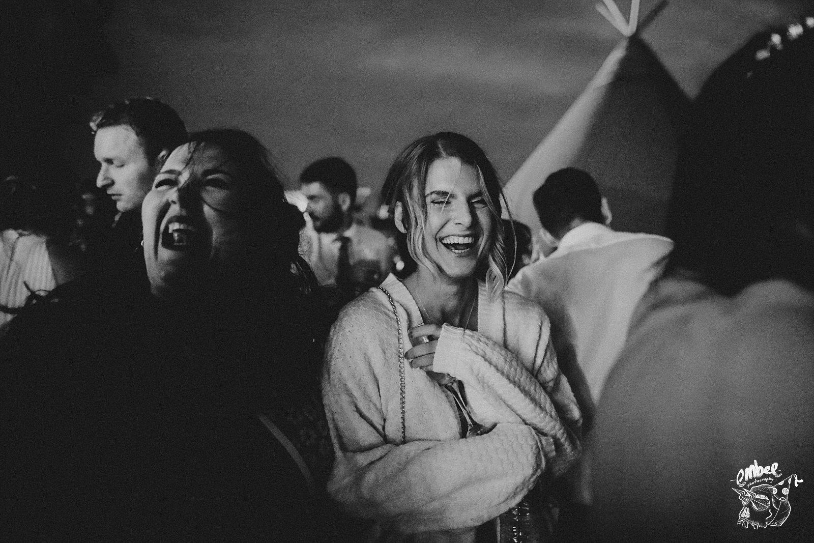 laughing woman at wedding