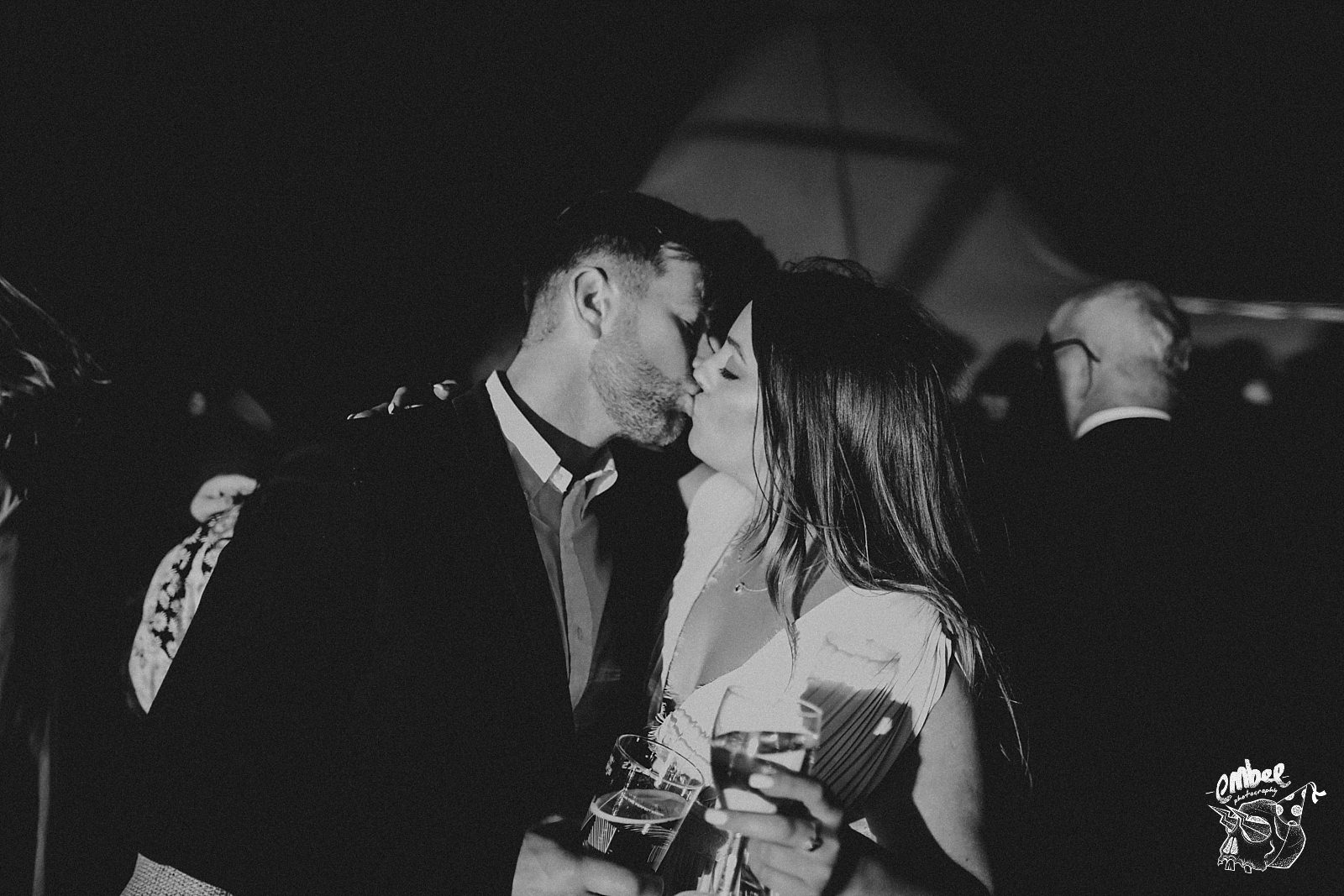 two guest kiss at wedding