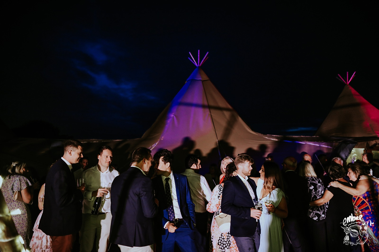 guests outside tipi at a wedding