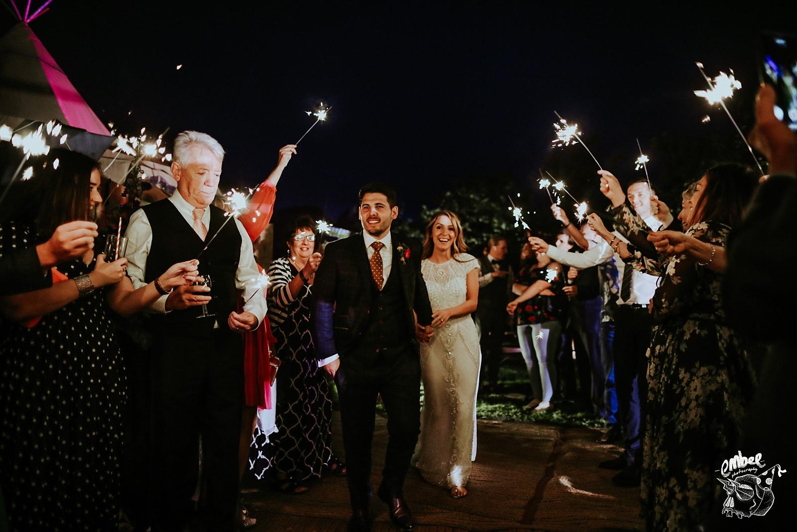 bride & groom walking through sparklers