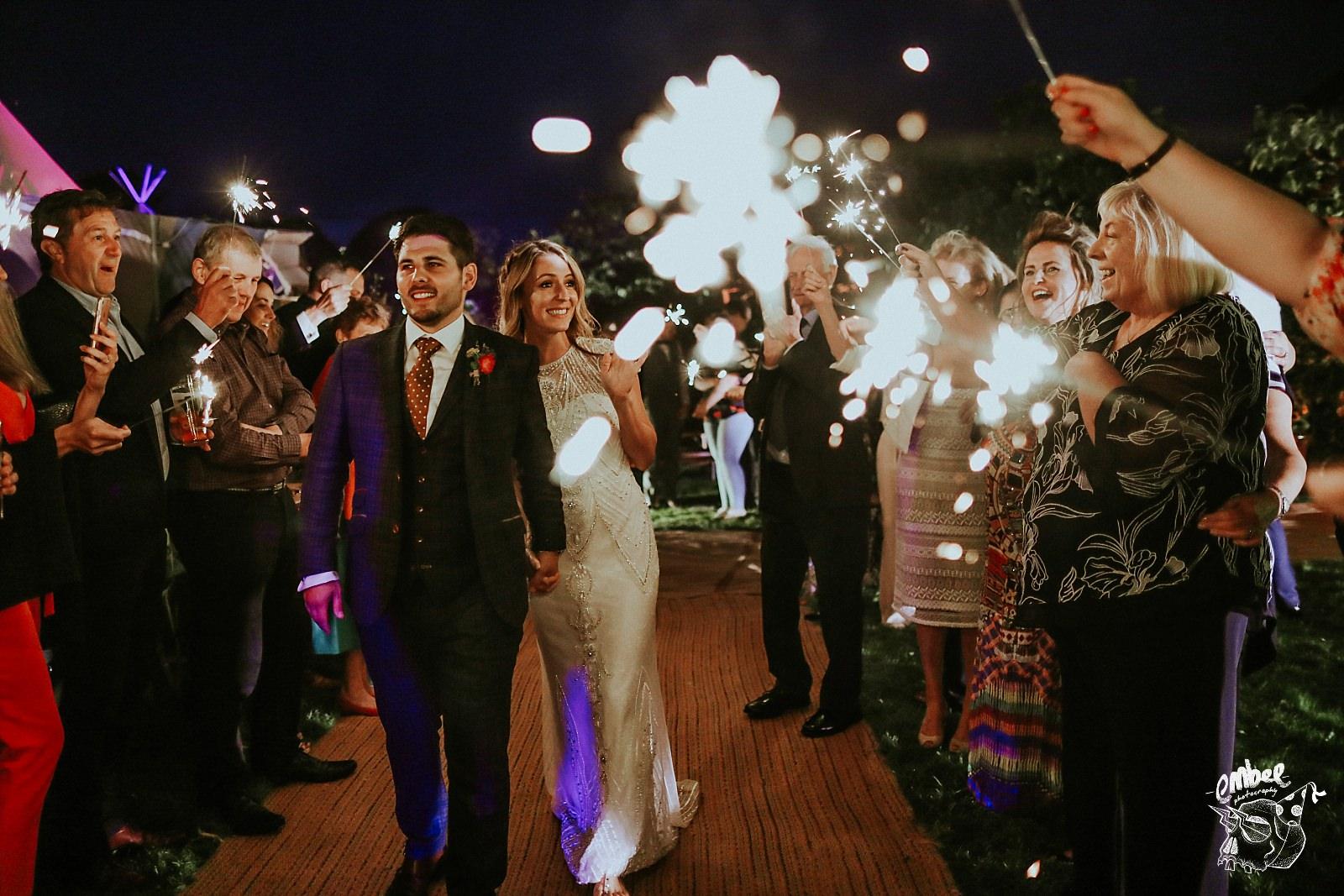 bride walking through sparklers