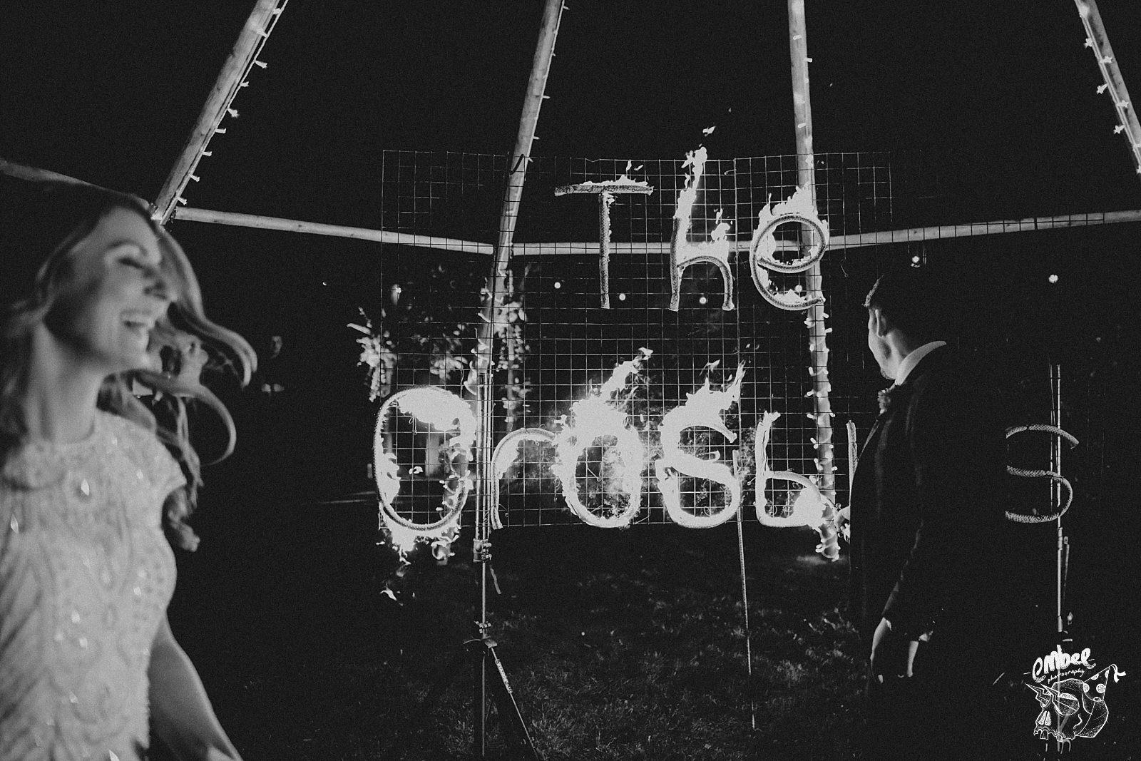 bride and groom light signwriting