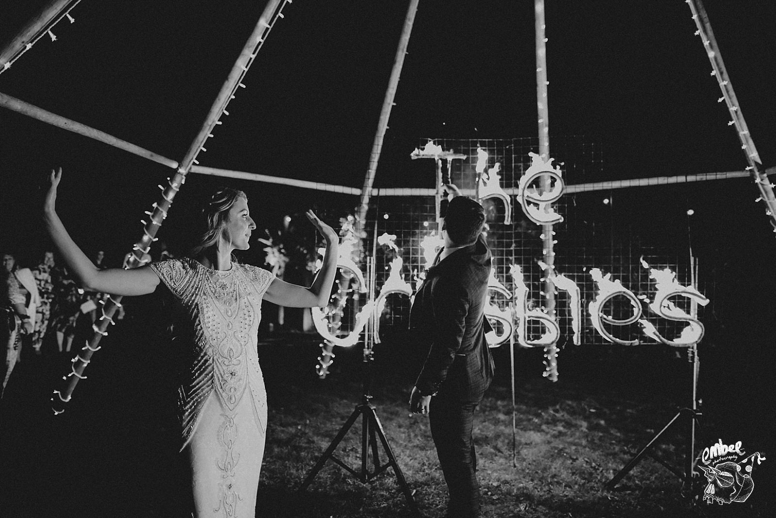 bride celebrates new name in fire writing