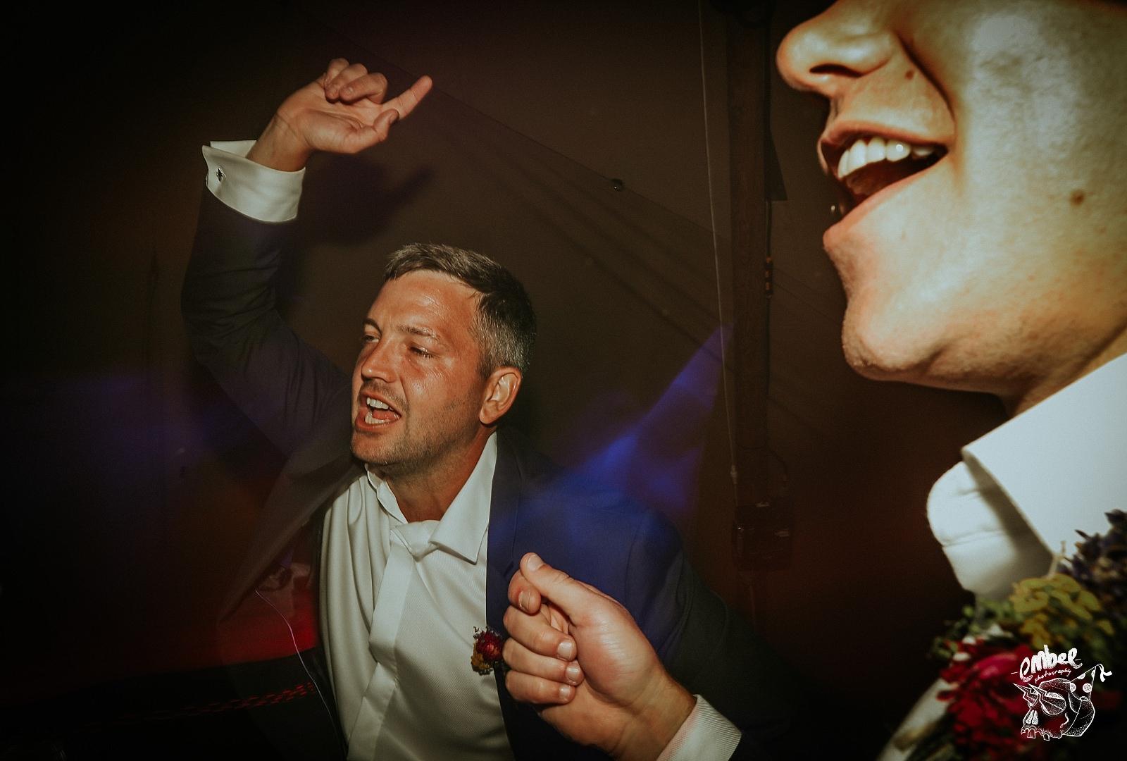 drunk wedding guest on dance floor