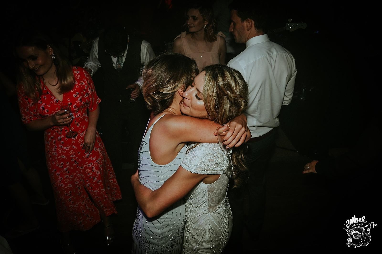 bride and sister hug