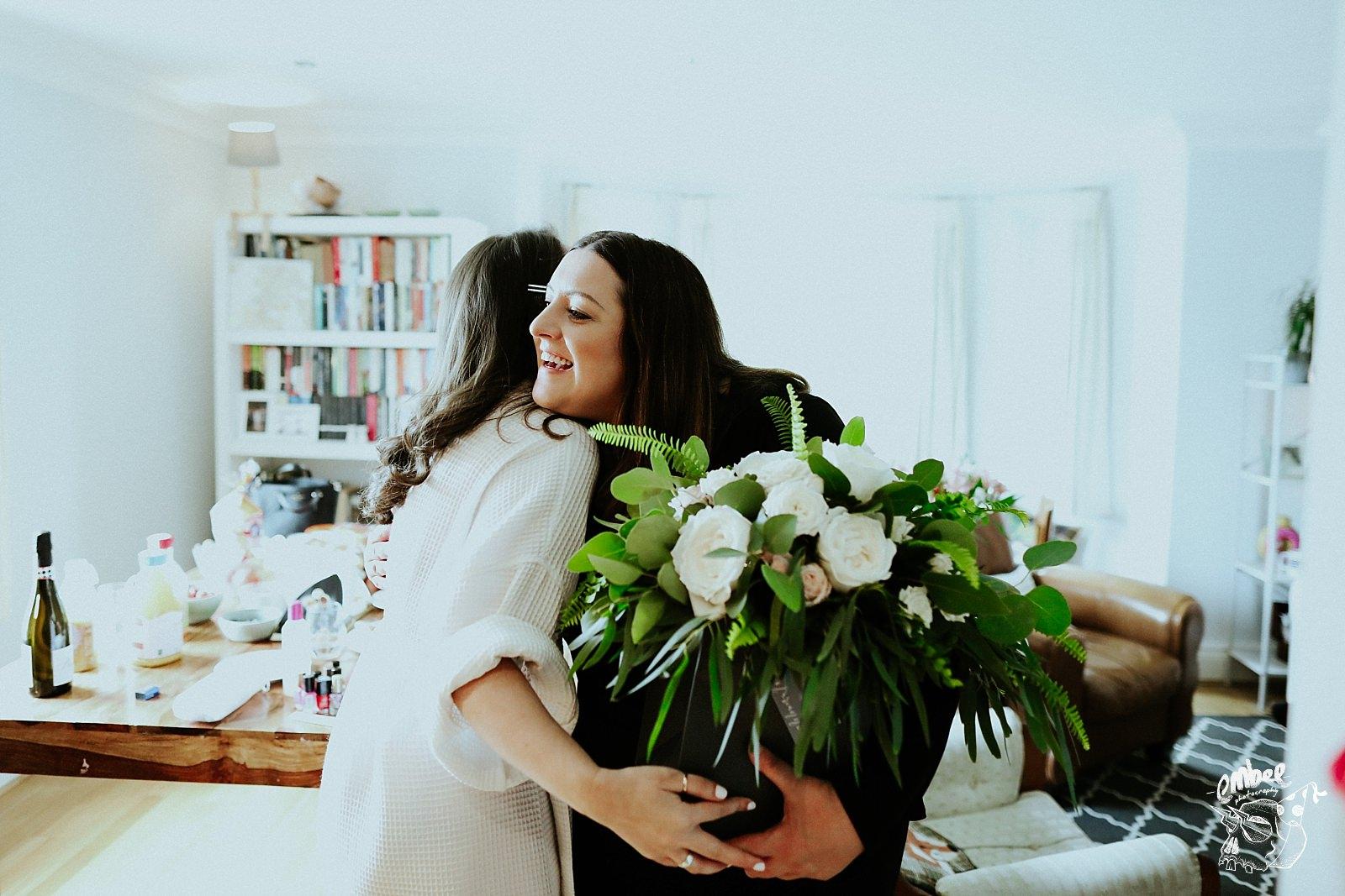 florist hugs bride