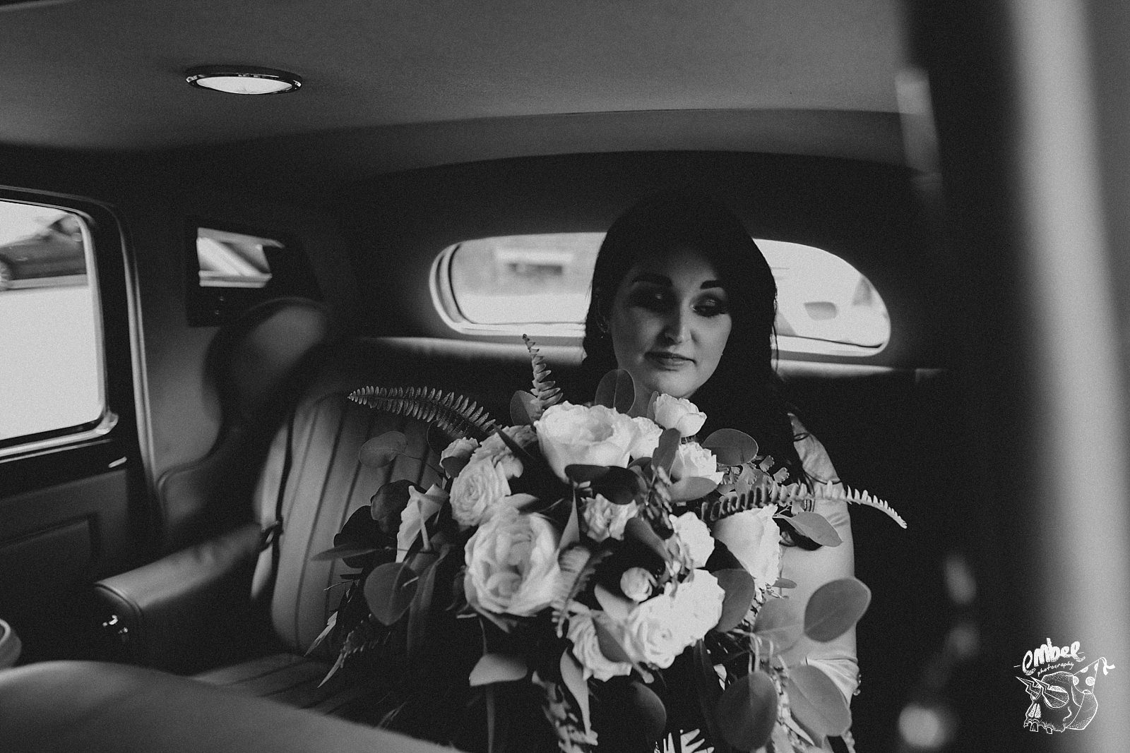 bride with flower in a car