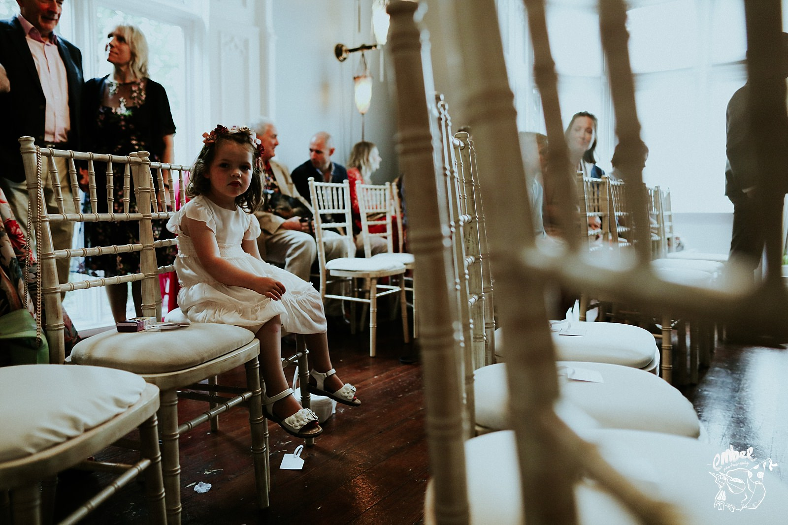 flower girl sat on chair