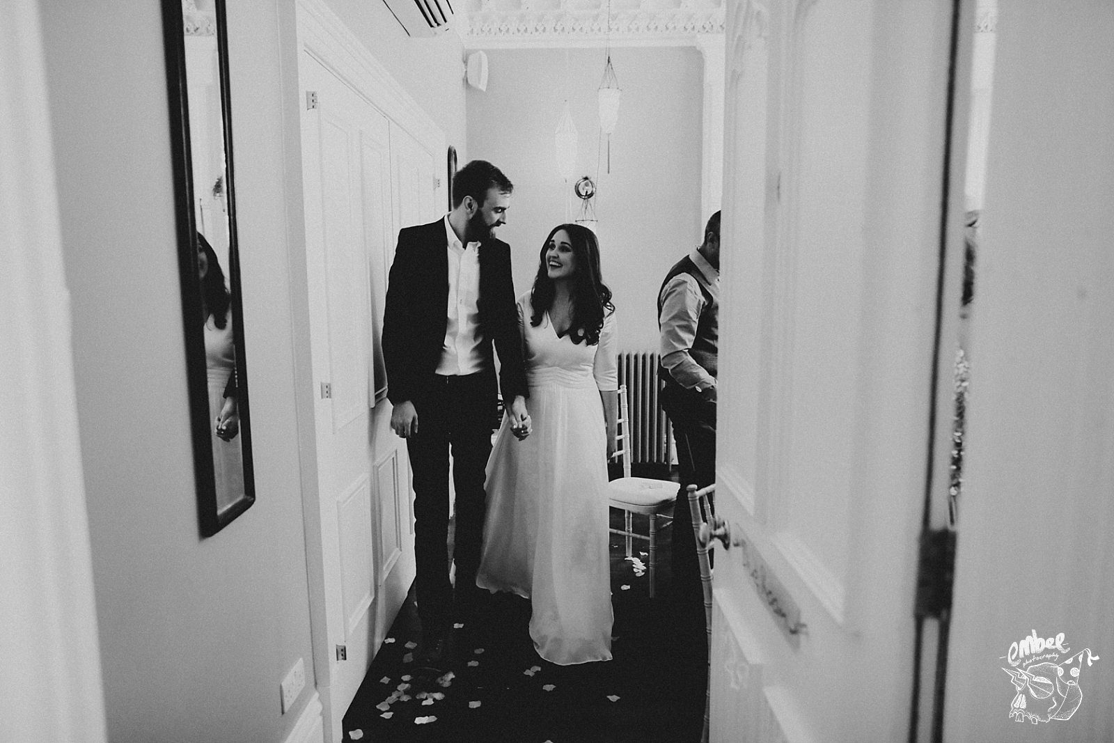 bride and groom leave ceremony room