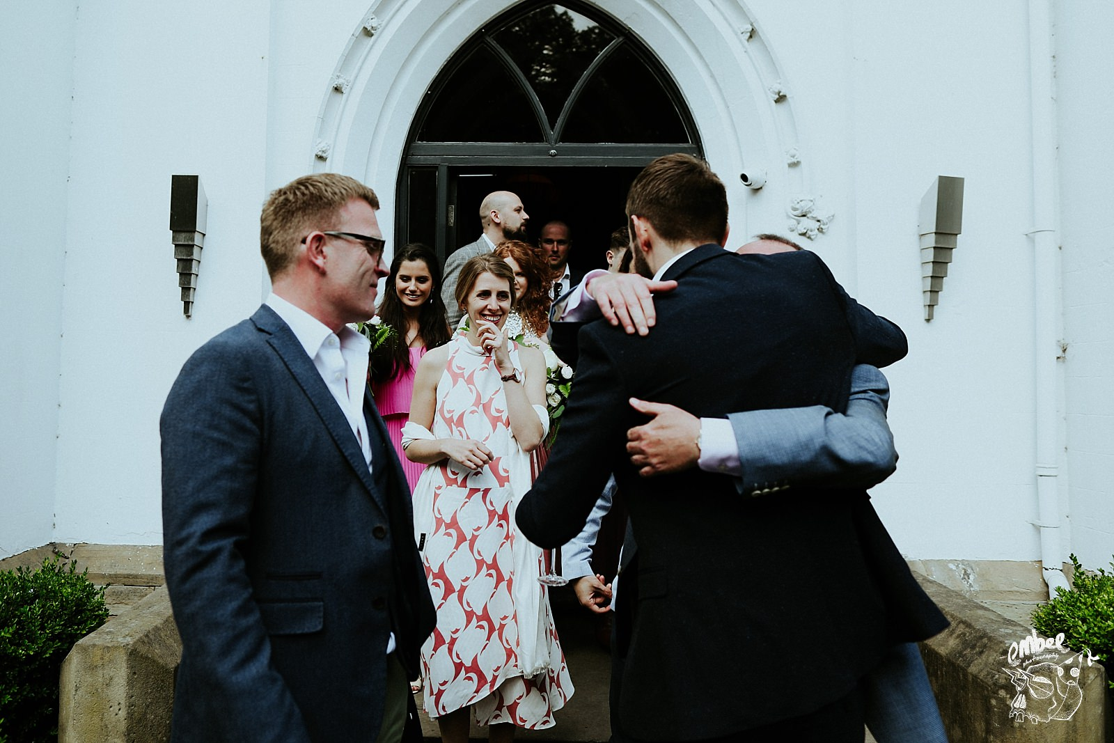 hugging at wedding