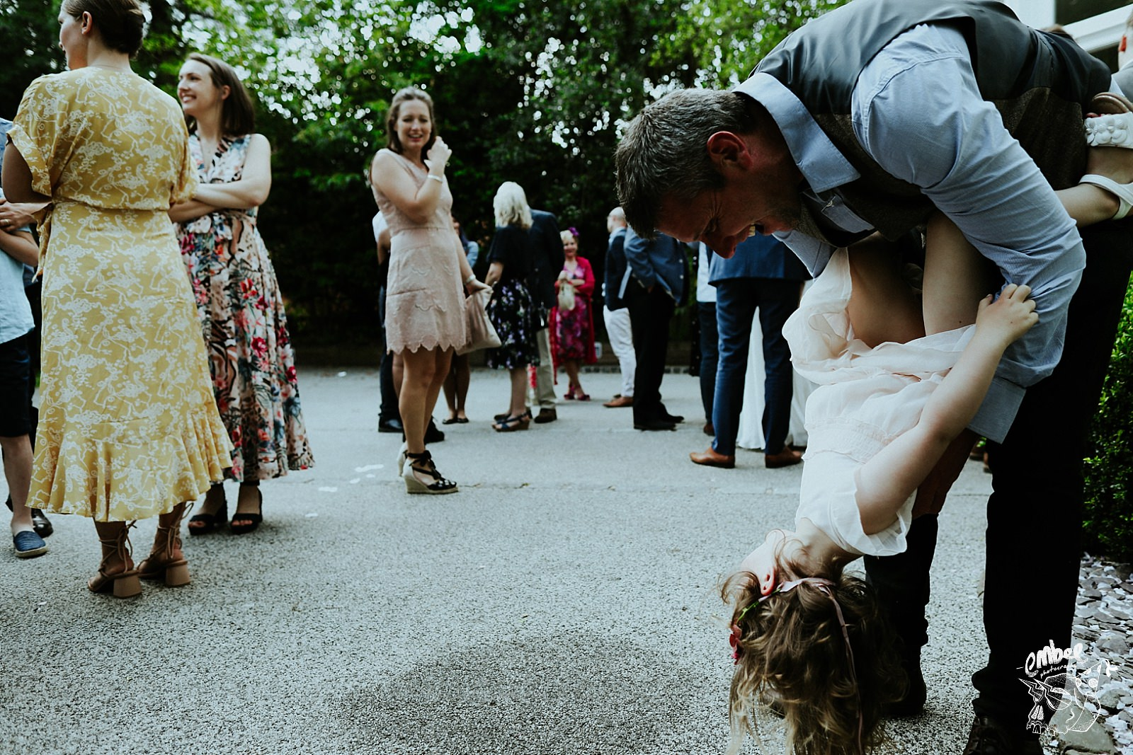 dad playing wiht kid at wedding