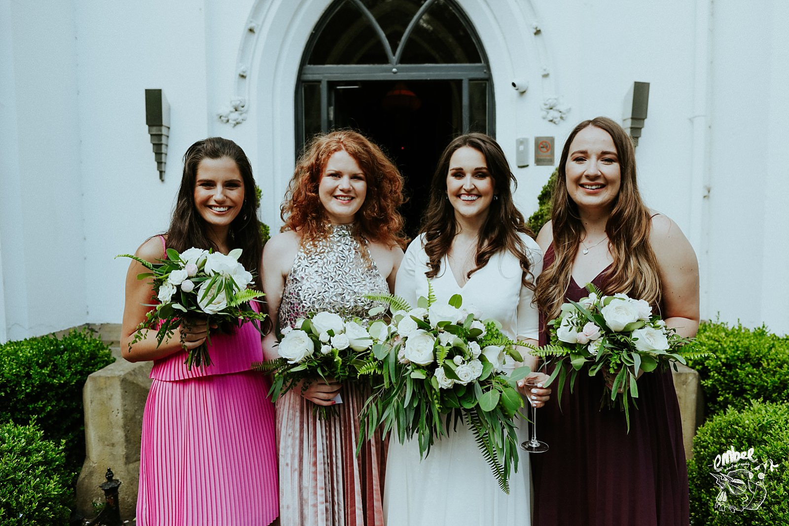 bride with bridesmaids and nice flowers