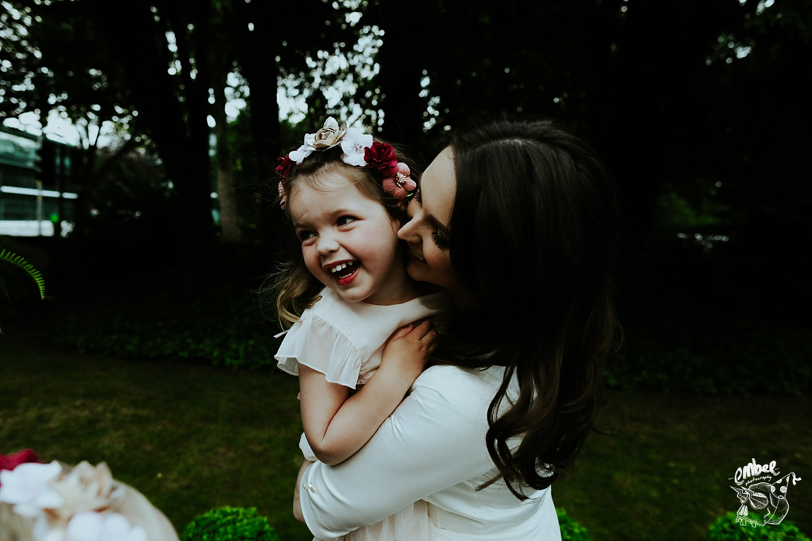 bride kisses child