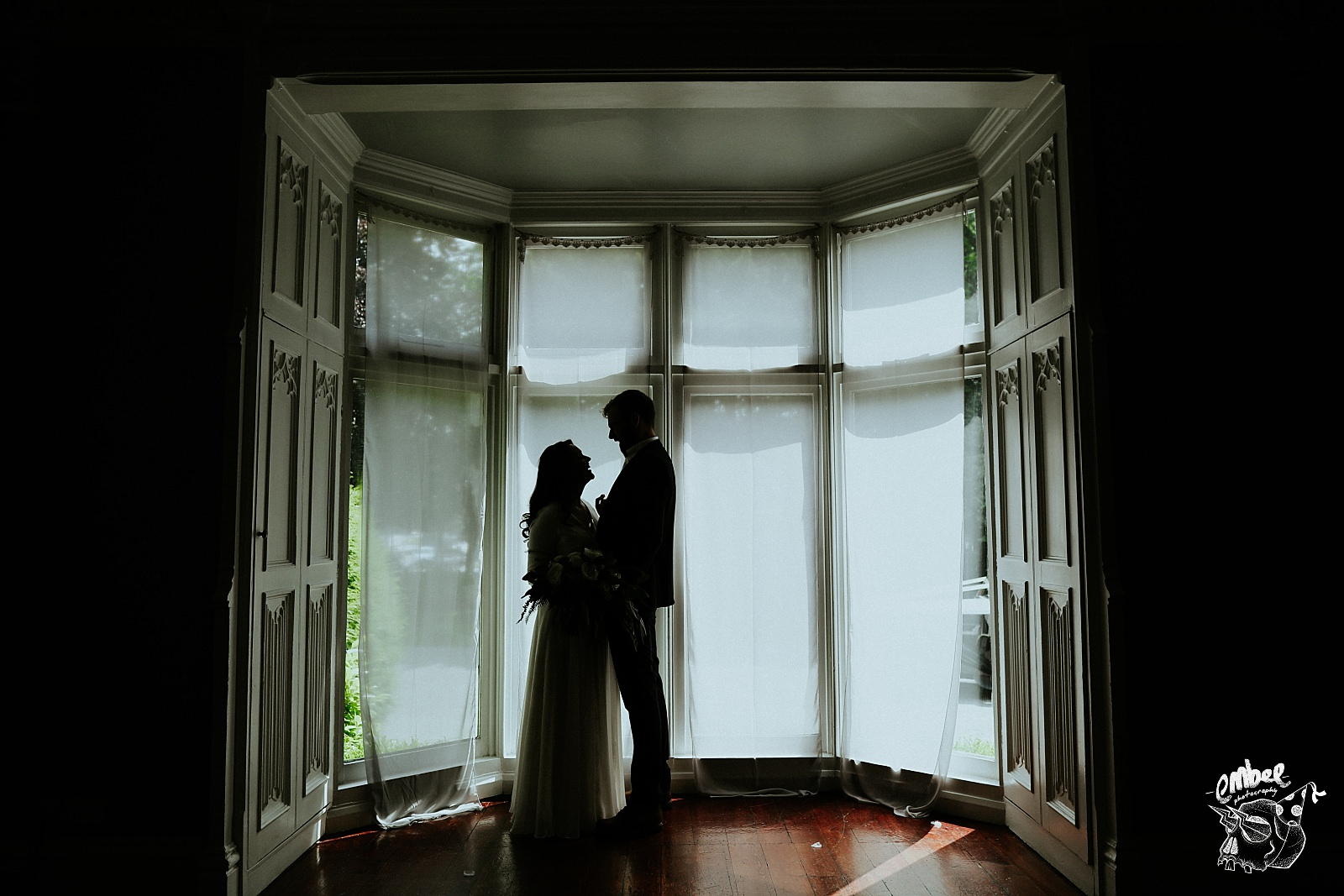 silhouette of bride and groom in didsbury house hotel