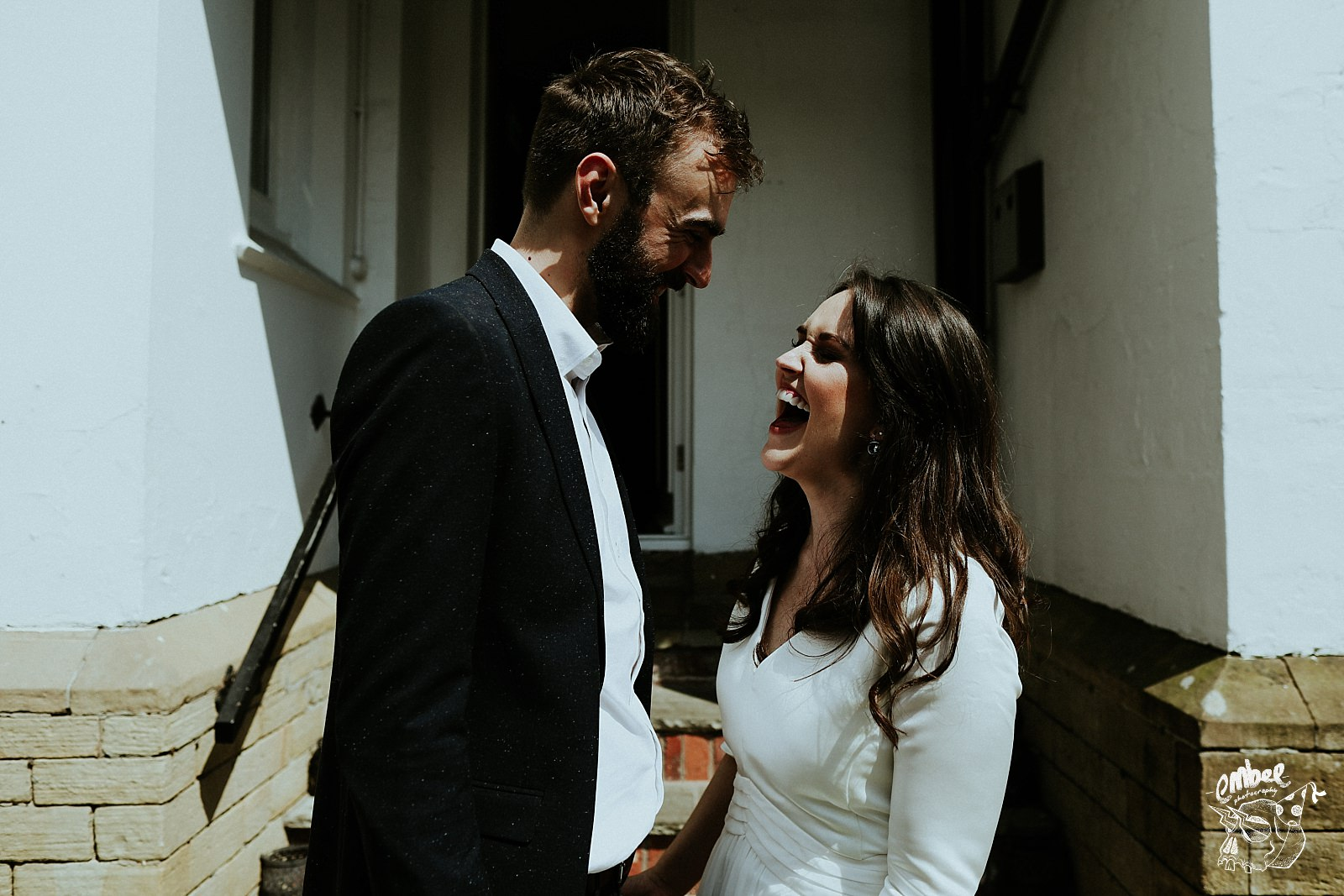bride laughing at groom