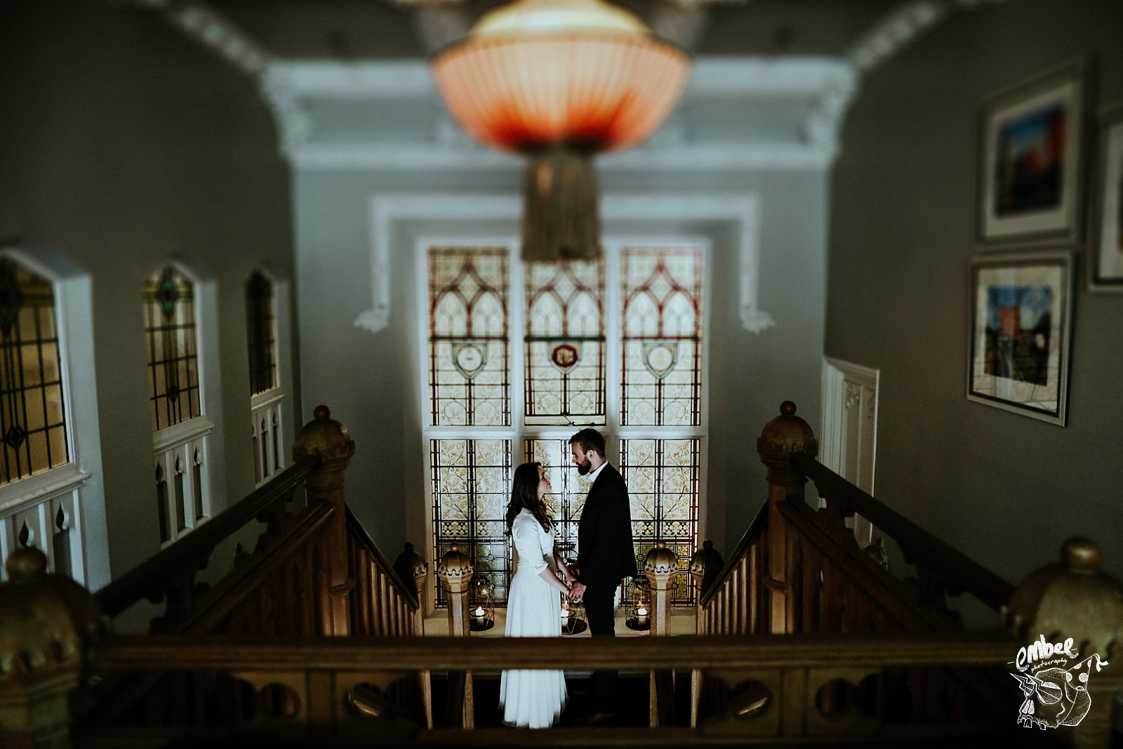 bride and groom on top of stairs in didsbury house hotel