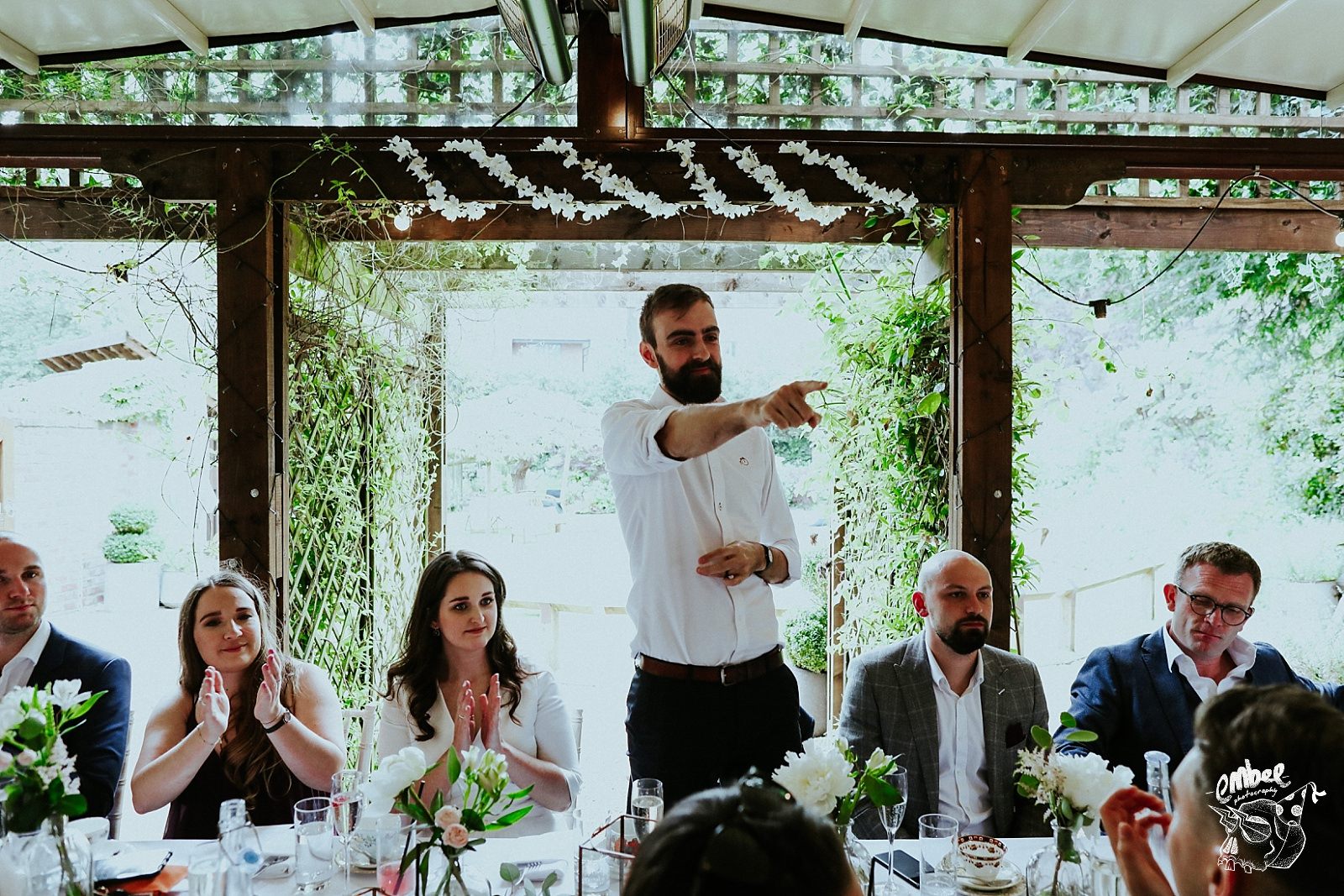 groom pointing during speech
