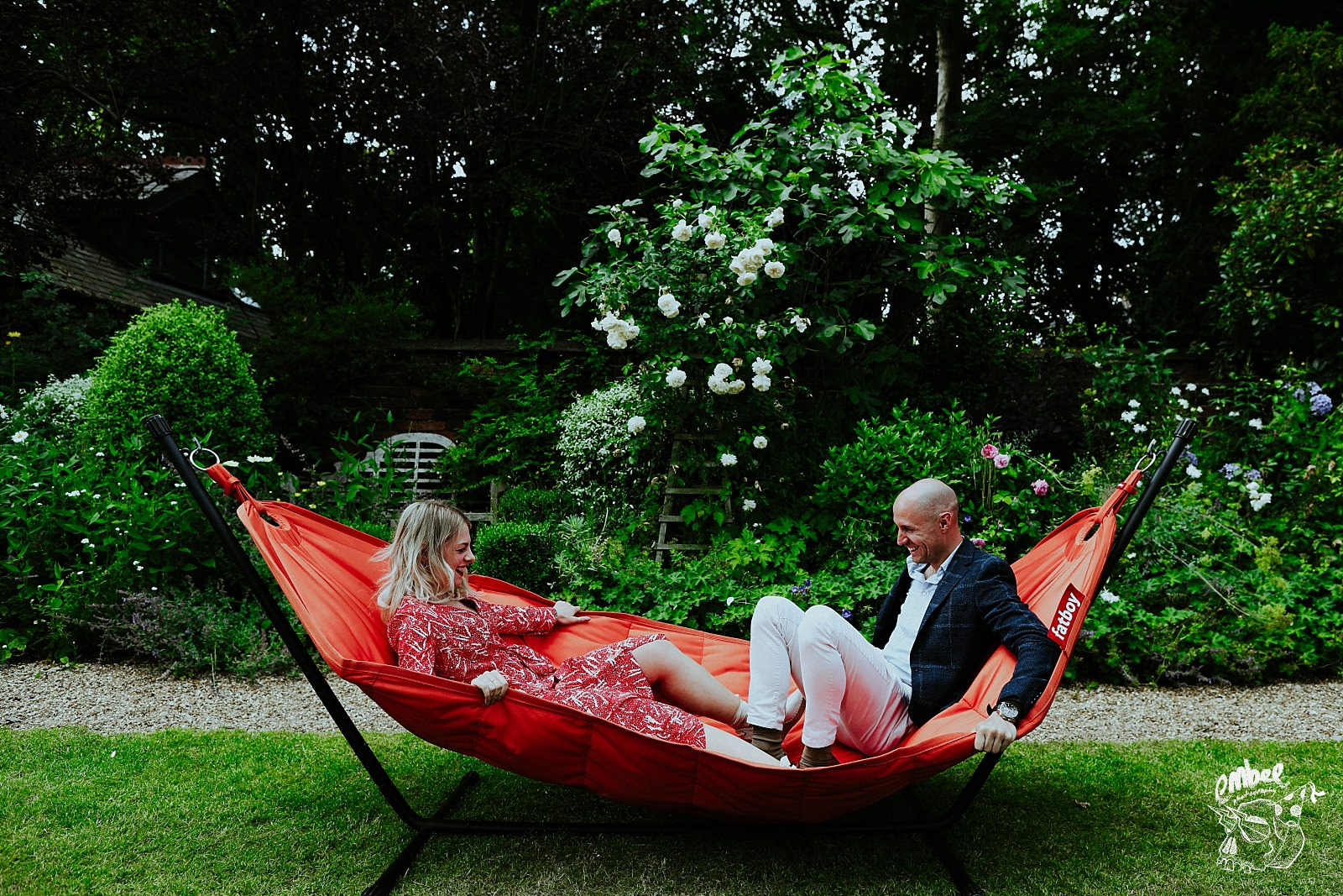 woman and man balance on a hammock