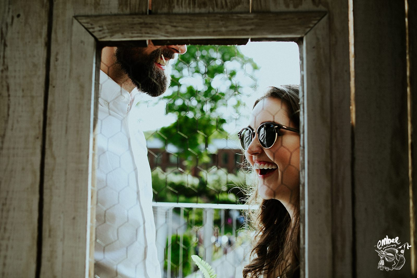 bride laughing with sun glasses on