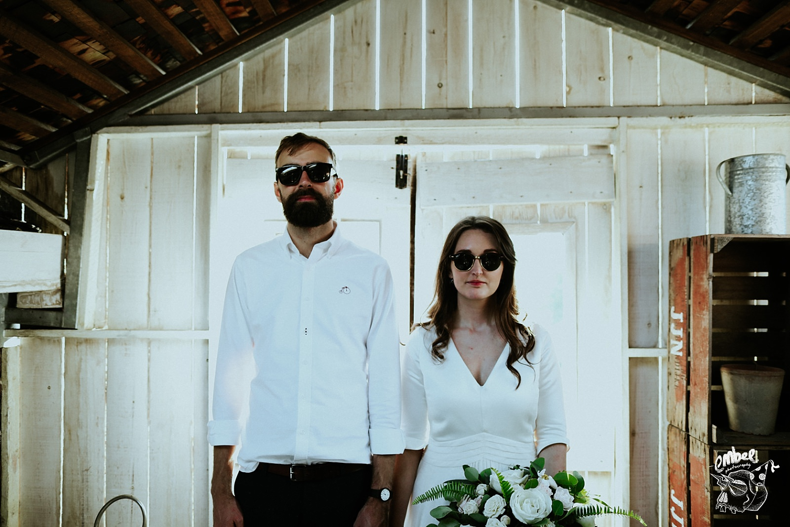 bride and groom looking with sun glasses on