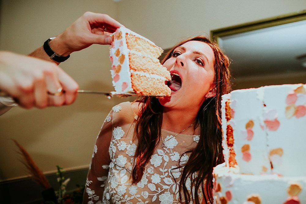 documentary photo of bride eating cake