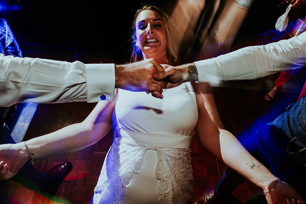 bride doing the limbo