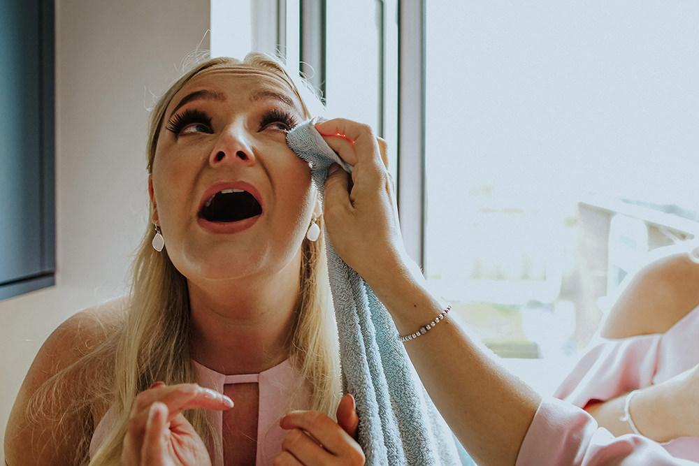 bridesmaid getting tear wiped away