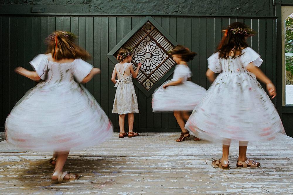 bridesmaids spinning arounf on stage
